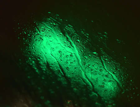 aqa: Green and black background with water drops. Stock Photo