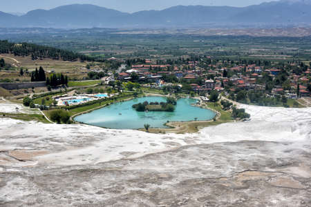 Landscape with lake surrounded of travertine, Pamukkale, Denizli, Turkey.