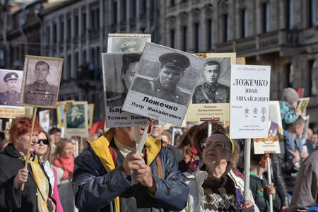 relatives: The action Immortal regiment on Victory parade. People go with portraits of their relatives, who participated in the Second World War. The celebration of 70 anniversary of Victory in the Great Patriotic War.