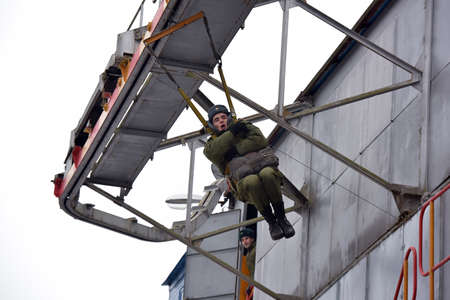 conscripts: Soldiers on the simulator learning to skydive, Russia.