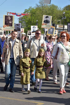 immortal: St.PETERSBURG, RUSSIA - MAY 9, 2016: Participants of Immortal Regiment - public action, during which participants carried portrait. Editorial