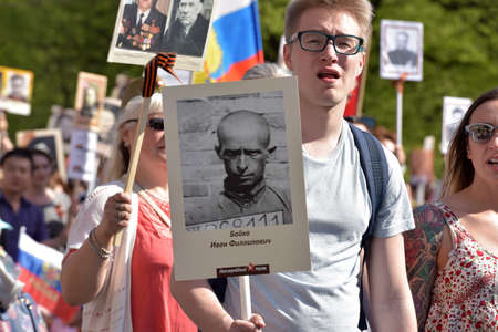 St.PETERSBURG, RUSSIA - MAY 9, 2016: Participants of Immortal Regiment - public action, during which participants carried portrait. Editorial