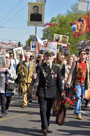 carried: St.PETERSBURG, RUSSIA - MAY 9, 2016: Participants of Immortal Regiment - public action, during which participants carried portrait. Editorial