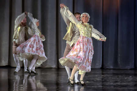 People dancing in traditional costumes on stage, performances dance group, St. Petersburg, Russia.