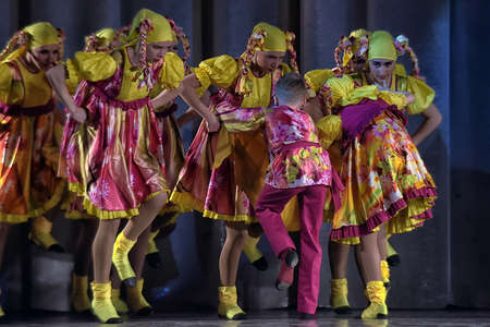 pas: Children s theatrical performance of dance group in national costumes