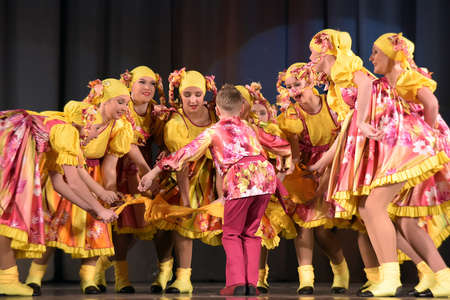Childrens theatrical performance of dance group in national costume, Russia, St. Petersburg.