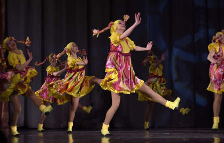 synchronously: Children s theatrical performance of dance group in national costumes