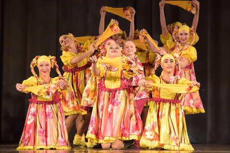 Children s theatrical performance of dance group in national costumes