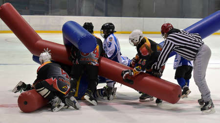 belgrade: Children play on ice hockey great comic inflatable sticks, Murmansk, Russia. Editorial