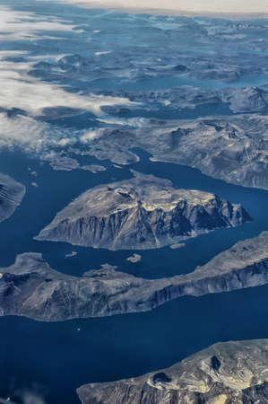 plane window: Greenland from the plane window. Stock Photo