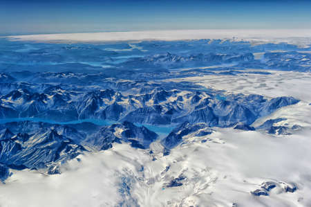 Greenland from the plane window. Stock Photo
