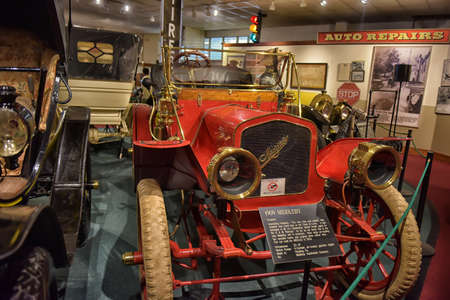 motorcoach: Antique American car in museum around other early twentieth century motorcars. 1910 Maxwell Roadster at car museum, Virginia. The Maxwell was built by the Maxwell Motor Company founded in Tarrytown, New York.
