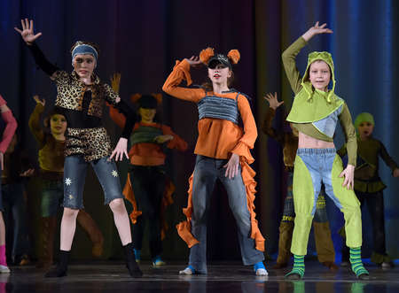 dramatics: Children dancing on the stage in animal costumes Editorial