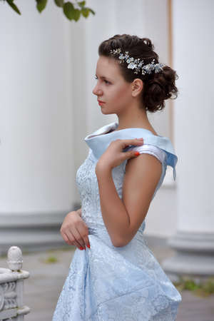Beautiful brunette in pale blue evening dress outdoor. Stock Photo