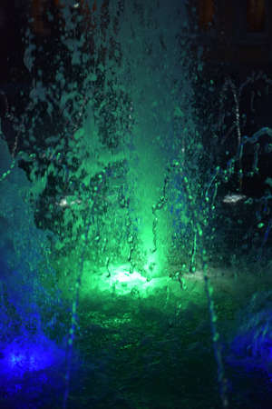 illuminated: fountain illuminated at night Stock Photo