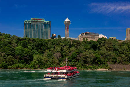 People aboard the boat called the Hornblower approaching the American falls and Canadian Horseshoe falls.