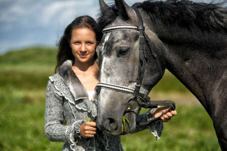 the furlough: Beautiful young teen girl with the brown horse.