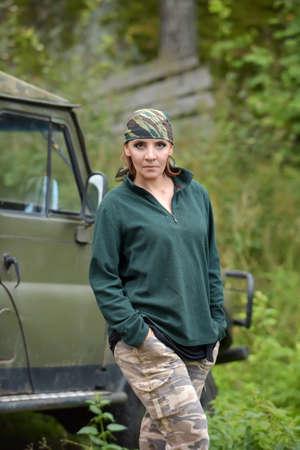 Woman wearing camouflage bandana and a green fleece jacket. Stock Photo