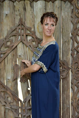 anglo saxon: Woman with a blue dress with an ethnic ornament. Stock Photo