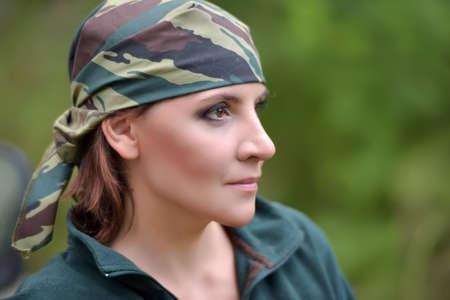 servicewoman: Woman wearing camouflage bandana and a green fleece jacket. Stock Photo