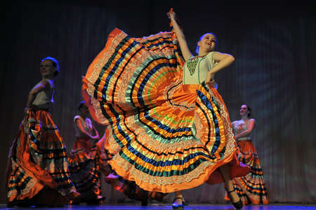 pas: Flamenco dance on stage. Beautiful gypsy dancers performing a traditional dance. Editorial