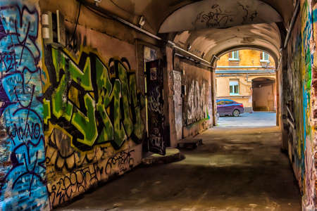 bare skinned: Arch with graffiti on the walls. Editorial