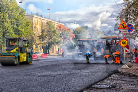 vibroroller: Replacement of the asphalt pavement in the road, St. Petersburg, Russia.