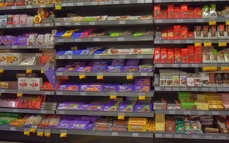 Wide variety of chocolate for sale on supermarket store shelves.