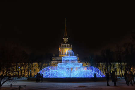 The Admiralty and fountains in New Year`s illumination, Saint-Petersburg. Editorial