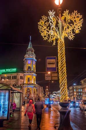 Busy automobile traffic on Nevsky prospect with Christmas lights