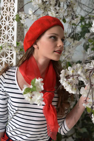A girl in a red beret in the spring Stock Photo
