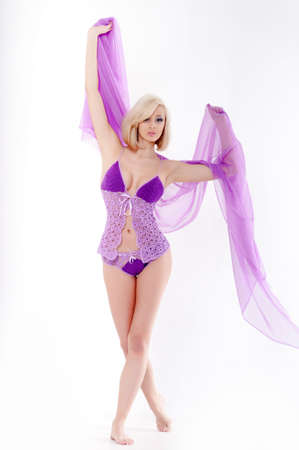 undergarment: Beautiful slender blonde dressed in purple lingerie