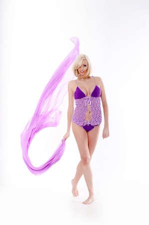 Beautiful slender blonde dressed in purple lingerie