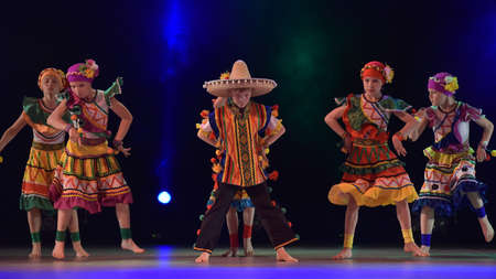 Children in Mexican costumes dance on stage, Theater of Choreographic Miniatures Style, Performance in St. Petersburg, Russia