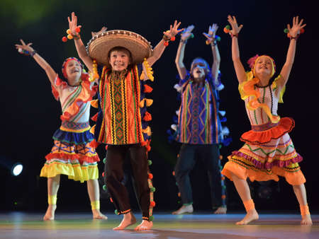 choreographic: Children in Mexican costumes dance on stage, Theater of Choreographic Miniatures Style, Performance in St. Petersburg, Russia