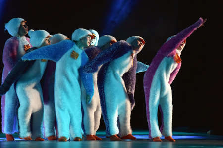 Children in a suit of penguins dance on a stage, Childrens dance group, Petersburg, Russia