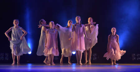 Girls in pink air dresses dancing on stage, Theater of Choreographic Miniatures Style, Performance in St. Petersburg, Russia