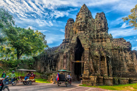 Siem Reap, Cambodia 29.06.2017  Gate to Angkor Thom lined by row of giant figures demons, Angkor, Cambodia