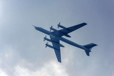 Russia, St. Petersburg, July 30, 2017 A ceremonial parade for the Day of the Russian Navy: The group of Soviet strategic bomber Tupolev Tu-95 Bear flies over Saint-Petersburg. Russian Navy parade in Saint.Petersburg Editorial
