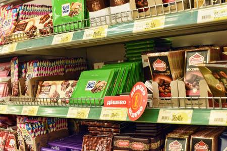 Russia, St. Petersburg, 01,03,2014 Chocolates on supermarket shelves Editorial