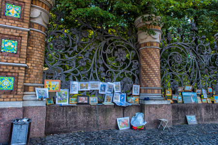 Russia, St. Petersburg, 23,09,2017 Works of artists on sale in the street on the fence of the Mikhailovsky Garden.