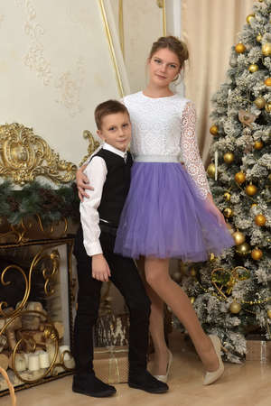 teen girl with her brother in costume at christmas time