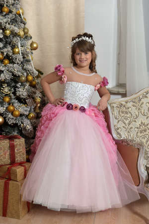 Young princess in white with pink elegant dress Stock Photo