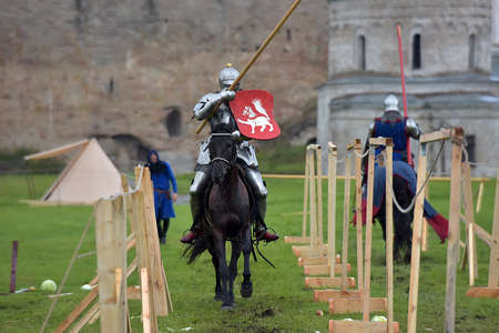 Russia, Ivangorod 01.08.2015 Festival of medieval reconstruction Russian fortress, Riders on a contest on spears