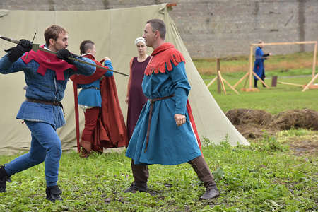 Russia, Ivangorod 01.08,2015 Festival of medieval reconstruction Russian fortress, Fencing on swords in medieval costumes Editorial