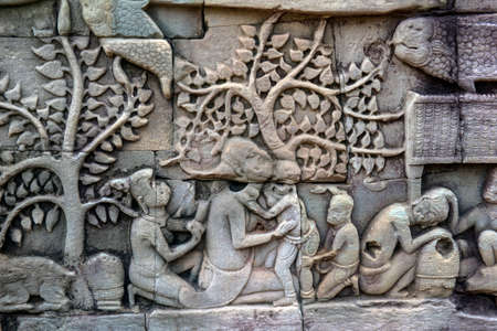 Siem Reap, Cambodia 08.08.2017 Bas relief sculpture, elephant charging into battle between the Cham and Khmer. Bayon Temple, Angkor Thom,