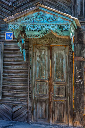 Russia, Irkutsk 06,05,2018 The door of the old house were planted in the ground