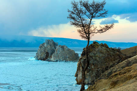 Baikal Lake.Shamanka Rock  and ice Stock Photo