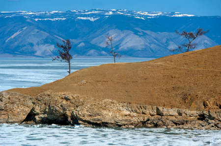 Olkhon Island in early May, rocks and ice of Lake Baikal