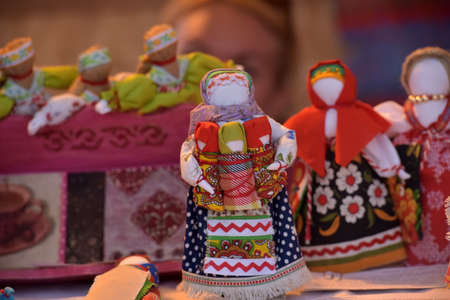 St. Peterburg,  Russia - 10,06,2018: Traditional Russian rag doll at Slavic culture fair. Handmade art textile faceless toy girl souvenir market